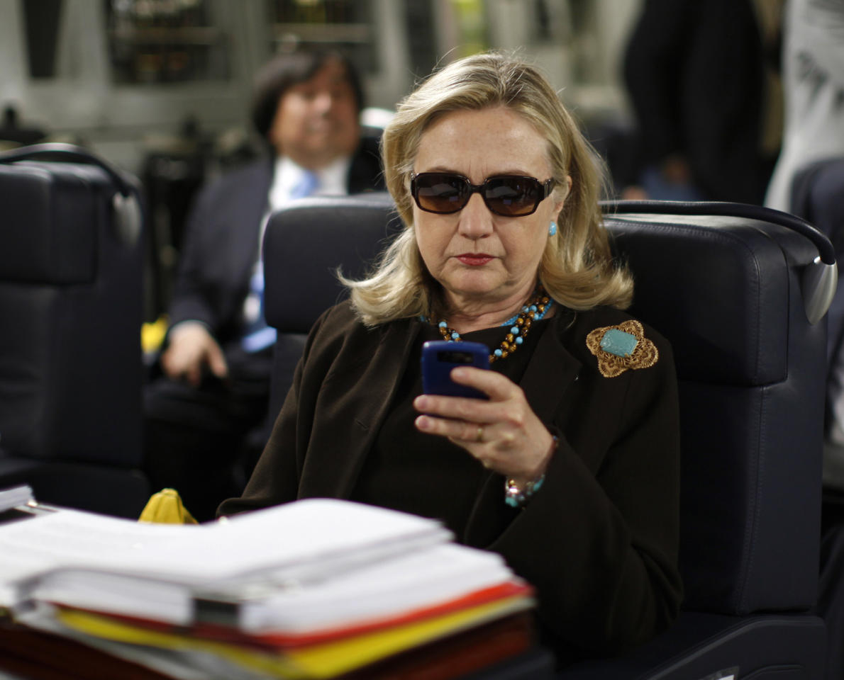 <p> FILE - In this Oct. 18, 2011, file photo, then-Secretary of State Hillary Rodham Clinton checks her Blackberry from a desk inside a C-17 military plane upon her departure from Malta, in the Mediterranean Sea, bound for Tripoli, Libya.Clinton is telling voters not to trust Donald Trump, but a new government report about her usage of a private server as secretary of state is complicating that message. The sharp rebuke from the State Department's Inspector General, which found Clinton did not seek legal approval for her homebrew email server, guarantees that the issue will remain alive and well for the likely Democratic presidential nominee. (AP Photo/Kevin Lamarque, Pool, File) </p>