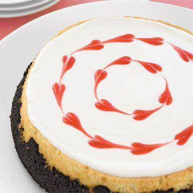 """<p>A swirl of red hearts makes this decadent cheesecake with a chocolate crust the perfect desert to indulge in this Valentine's Day.</p><p><em><a href=""""https://www.womansday.com/food-recipes/food-drinks/recipes/a23956/sweetheart-cheesecake/"""" target=""""_blank"""">Get the Sweetheart Cheesecake recipe.</a></em><em><br></em></p>"""