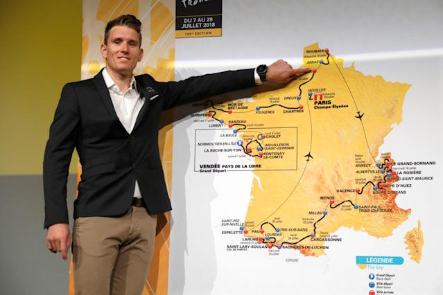 Rider Arnaud Demare points at the map of the itinerary of the 2018 Tour de France cycling race during a news conference in Paris, France, October 17, 2017. The world's greatest cycling event will start from Noirmoutier-en-L'Ile on July 7 and will finish at the Champs Elysees in Paris on July 29. REUTERS/Charles Platiau