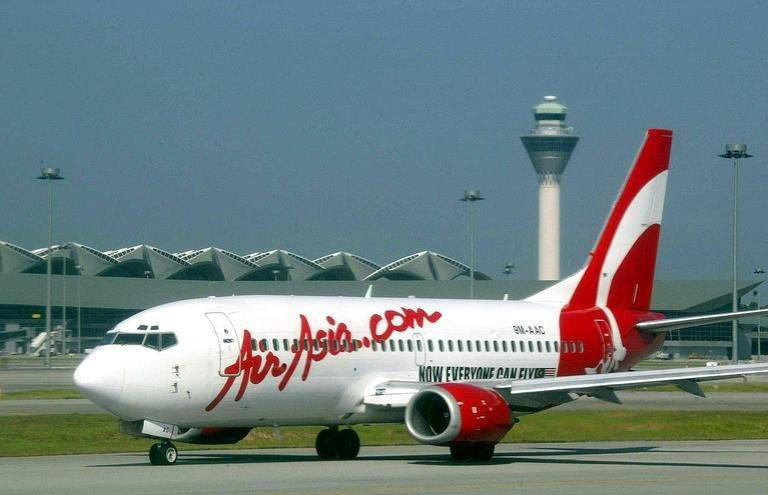 An Air Asia plane prepares for take-off at Kuala Lumpur airport February 8, 2003