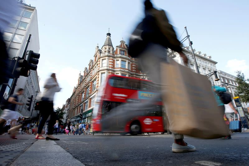 FILE PHOTO: Shoppers crossing the road in Oxford Street, in London