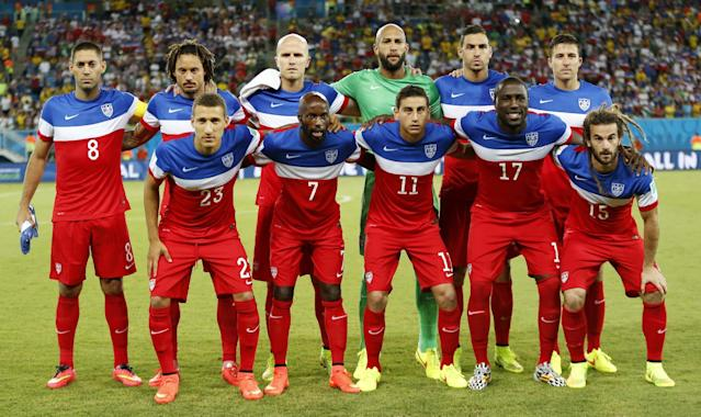 The USA team poses for a photo before the group G World Cup soccer match between Ghana and the United States at the Arena das Dunas in Natal, Brazil, Monday, June 16, 2014. (AP Photo/Julio Cortez)