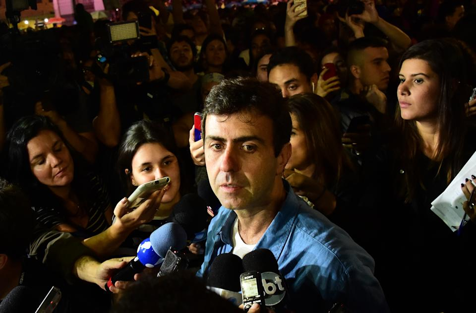 Candidate for mayor of Rio, Marcelo Freixo (PSOL), speaks to the media after losing the second round of the election with Marcelo Crivella of the Brazilian Republican Party (PRB), at Cinelandia square in Rio de Janeiro, Brazil on October 30, 2016. This was the second round of balloting for city halls around Latin America's biggest country and confirmed the trend seen in October 2 polls which ended in humiliation for the former governing Workers' Party. / AFP / TASSO MARCELO        (Photo credit should read TASSO MARCELO/AFP via Getty Images)