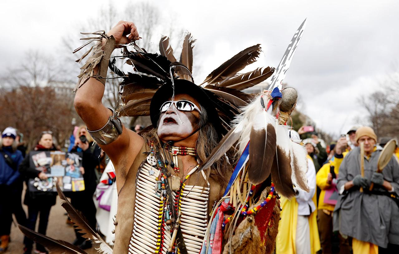 <p>Little Thunder, a traditional dancer and indigenous activist from the Lakota tribe, dances as he demonstrates in front of the White House during a protest march and rally in opposition to the Dakota Access and Keystone XL pipelines in Washington, U.S., March 10, 2017. (Kevin Lamarque/Reuters) </p>