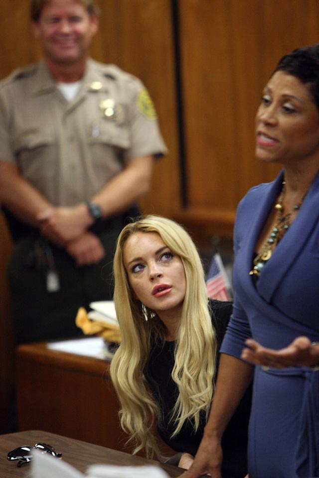 "Lindsay Lohan's legal woes continue. After the judge handed down a sentence of 90 days in jail followed by 90 days in rehab Tuesday, Lohan's lawyer, Shawn Chapman Holley, resigned Thursday. LiLo has reportedly hired a new attorney, legal newcomer Tiffany Feder-Cohen, for her appeal. Stay tuned. POOL/<a href=""http://www.infdaily.com"" target=""new"">INFDaily.com</a> - July 6, 2010"
