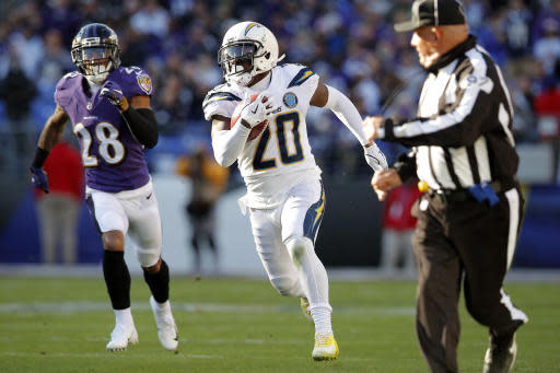 Los Angeles Chargers defensive back Desmond King (20) rushes the ball past Baltimore Ravens cornerback Anthony Averett in the second half of an NFL wild card playoff football game, Sunday, Jan. 6, 2019, in Baltimore. (AP Photo/Carolyn Kaster)