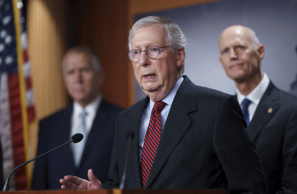 Senate Minority Leader Mitch McConnell, R-Ky., joined by GOP leaders, talks to reporters briefly to warn that Republicans will block the House-passed measure to keep the government funded and suspend the federal debt limit despite setting up a high-stakes showdown that will risk of triggering a fiscal crisis, at the Capitol in Washington, Wednesday, Sept. 22, 2021. (AP Photo/J. Scott Applewhite)