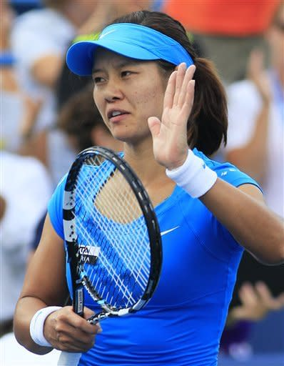 Li Na, from China, acknowledges the crowd after defeating Angelique Kerber, from Germany, 1-6, 6-3, 6-1 in the women's final at the Western & Southern Open tennis tournament on Sunday, Aug. 19, 2012, in Mason, Ohio. (AP Photo/Al Behrman)