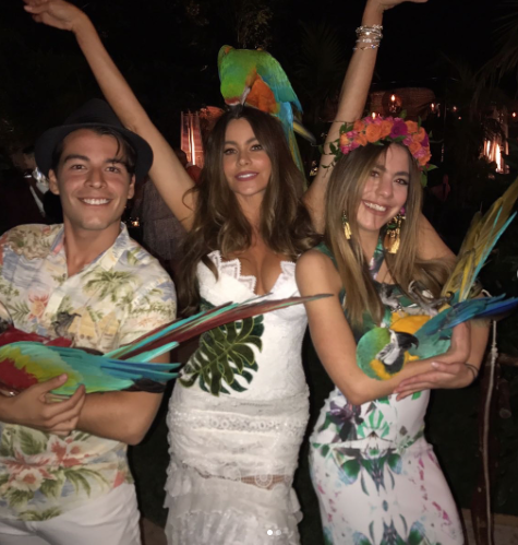 "<p>Once the bash finally got underway, guests mingled with live macaws. ""@cdvergara @manologonzalezvergara con las Guacamayas!!"" the actress explained beside a shot of herself between her son, Manolo, and niece Claudia, each with a bird in hand. Naturally, Vergara had a bird perched on her shoulders peering over her head. (Photo: <a href=""https://www.instagram.com/p/BUsBln8F4WU/"" rel=""nofollow noopener"" target=""_blank"" data-ylk=""slk:Sofia Vergara via Instagram"" class=""link rapid-noclick-resp"">Sofia Vergara via Instagram</a>) </p>"
