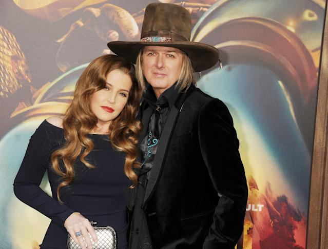 "We'd say this was a photo of Lisa Marie Presley and Michael Lockwood in happier times, but it was from 2015 — during the last year of their marriage, and she said she was ""abusing cocaine terribly"" during this period in addition to spending as many as five stints in rehab. (Photo: Getty Images)"