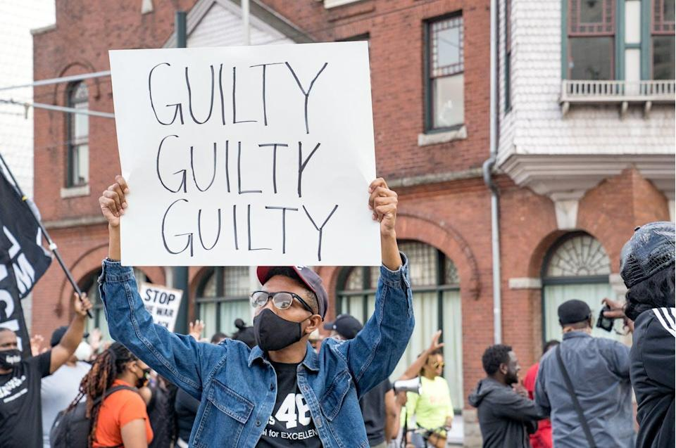 """<span class=""""caption"""">In Atlanta, Ga., one person's sign reflects the actual verdicts that had just been delivered in the Derek Chauvin trial. </span> <span class=""""attribution""""><a class=""""link rapid-noclick-resp"""" href=""""https://www.gettyimages.com/detail/news-photo/people-march-through-the-streets-after-the-verdict-was-news-photo/1232429084?adppopup=true"""" rel=""""nofollow noopener"""" target=""""_blank"""" data-ylk=""""slk:Megan Varner/Getty Images"""">Megan Varner/Getty Images</a></span>"""