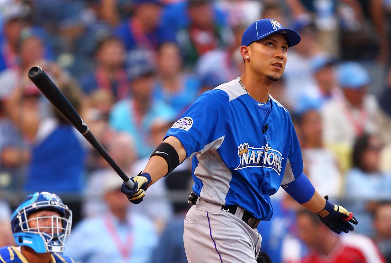 KANSAS CITY, MO - JULY 09:  National League All-Star Carlos Gonzalez #5 of the Colorado Rockies at bat in the first round during the State Farm Home Run Derby at Kauffman Stadium on July 9, 2012 in Kansas City, Missouri.  (Photo by Dilip Vishwanat/Getty Images)