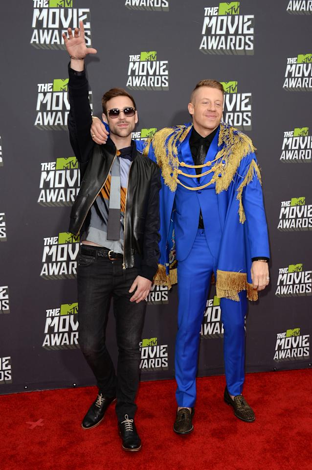 CULVER CITY, CA - APRIL 14:  Musicians Ryan Lewis (L) and Macklemore arrive at the 2013 MTV Movie Awards at Sony Pictures Studios on April 14, 2013 in Culver City, California.  (Photo by Jason Merritt/Getty Images)