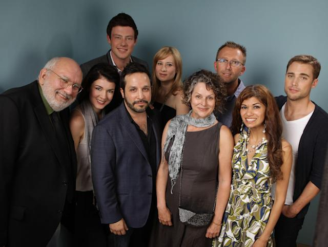 "TORONTO, ON - SEPTEMBER 11: Actor Jay Brazeau, actress Gabrielle Miller, actor Cory Monteith, Ben Ratner, Gabrielle Rose, Leena Manro, actress Camille Sullivan, director Carl Bessai, and actor Dustin Milligan of ""Sisters & Brothers"" poses during the 2011 Toronto Film Festival at Guess Portrait Studio on September 11, 2011 in Toronto, Canada. (Photo by Matt Carr/Getty Images)"