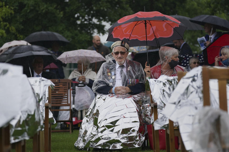 D-Day veterans arrive to watch the official opening of the British Normandy Memorial in France via a live feed, during a ceremony at the National Memorial Arboretum in Alrewas, England, Sunday June 6, 2021. Several ceremonies are scheduled on Sunday to commemorate the 77th anniversary of D-Day that led to the liberation of France and Europe from the German occupation. On June 6, 1944, more than 150,000 Allied troops landed on code-named beaches, carried by 7,000 boats. (Jacob King/PA via AP)
