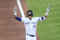 Toronto Blue Jays' Lourdes Gurriel Jr. celebrates after hitting a grand slam home run during the first inning of a baseball game against the Baltimore Orioles in Buffalo, N.Y., Thursday, June 24, 2021. (AP Photo/Joshua Bessex)