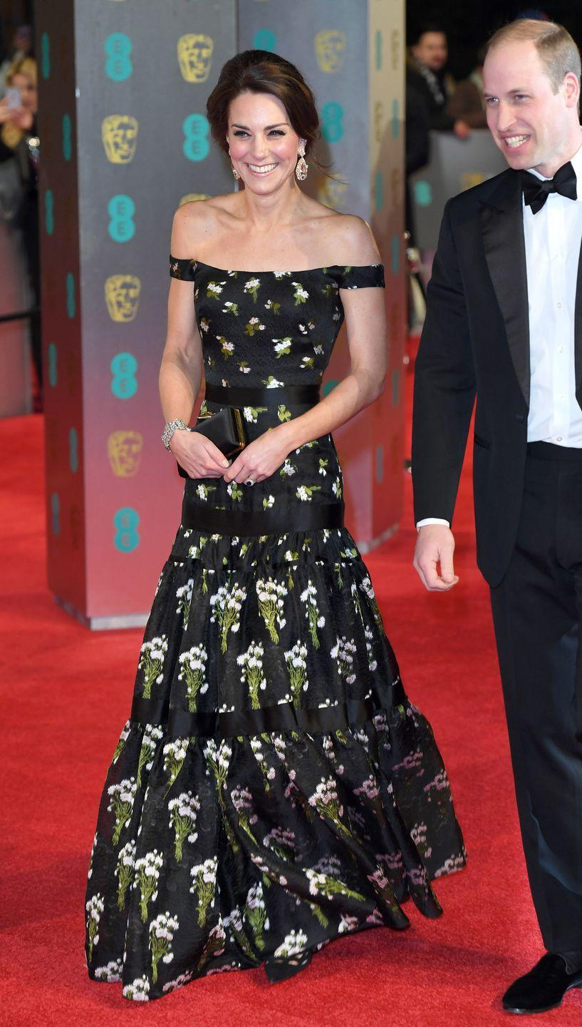 <p>Kate Middleton wears an Alexander McQueen gown while attending the BAFTA's with husband Prince William in London</p>