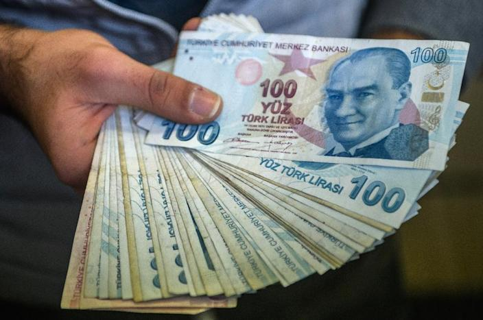 The value of the Turkish lira slid on Thursday after the central bank disappointed markets expecting a sharp rate hike to counter galloping inflation and the weakness of the currency. (AFP Photo/OZAN KOSE)