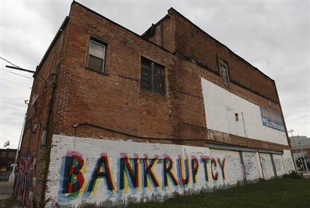 "The word ""Bankruptcy"" is painted on the side of a building in Detroit, Michigan"