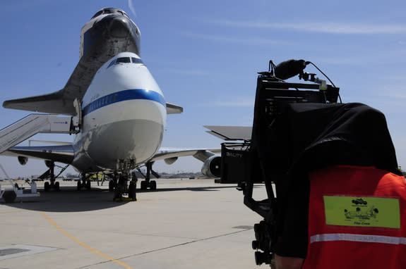 A cameraman shoots the space shuttle Endeavour after its arrival at Los Angeles International Airport on Sept. 21, 2012.