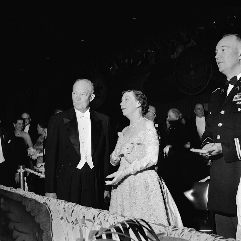 """<p>For the President's second inauguration, First Lady Mamie Eisenhower wore a gown similar to what she wore to her husband's first inauguration, which she purchased from <a href=""""https://www.eisenhowerlibrary.gov/sites/default/files/research/online-documents/inauguration-1957/letter-bonwit-teller-bill.pdf"""" rel=""""nofollow noopener"""" target=""""_blank"""" data-ylk=""""slk:Bonwit Teller for $500"""" class=""""link rapid-noclick-resp"""">Bonwit Teller for $500</a>. </p>"""