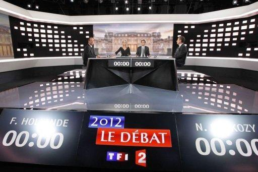 Francois Hollande (L) and Nicolas Sarkozy (R) pose with journalists David Pujadas (C-R) and Laurence Ferrari (C-L) prior to the start of their national TV debate between the two rounds of presidential election, at the TV broadcast studio in La Plaine Saint-Denis, outside Paris. Sarkozy launched fierce assaults on his rival Hollande in their pre-poll debate but failed to land a decisive blow