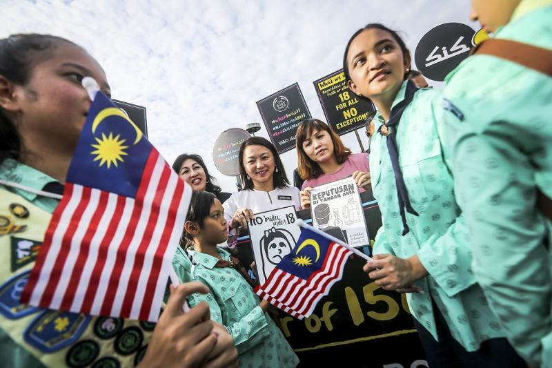 Deputy Women, Family and Community Development Minister Hannah Yeoh (centre) and students protest against child marriage outside the Parliament in Kuala Lumpur November 13, 2018.