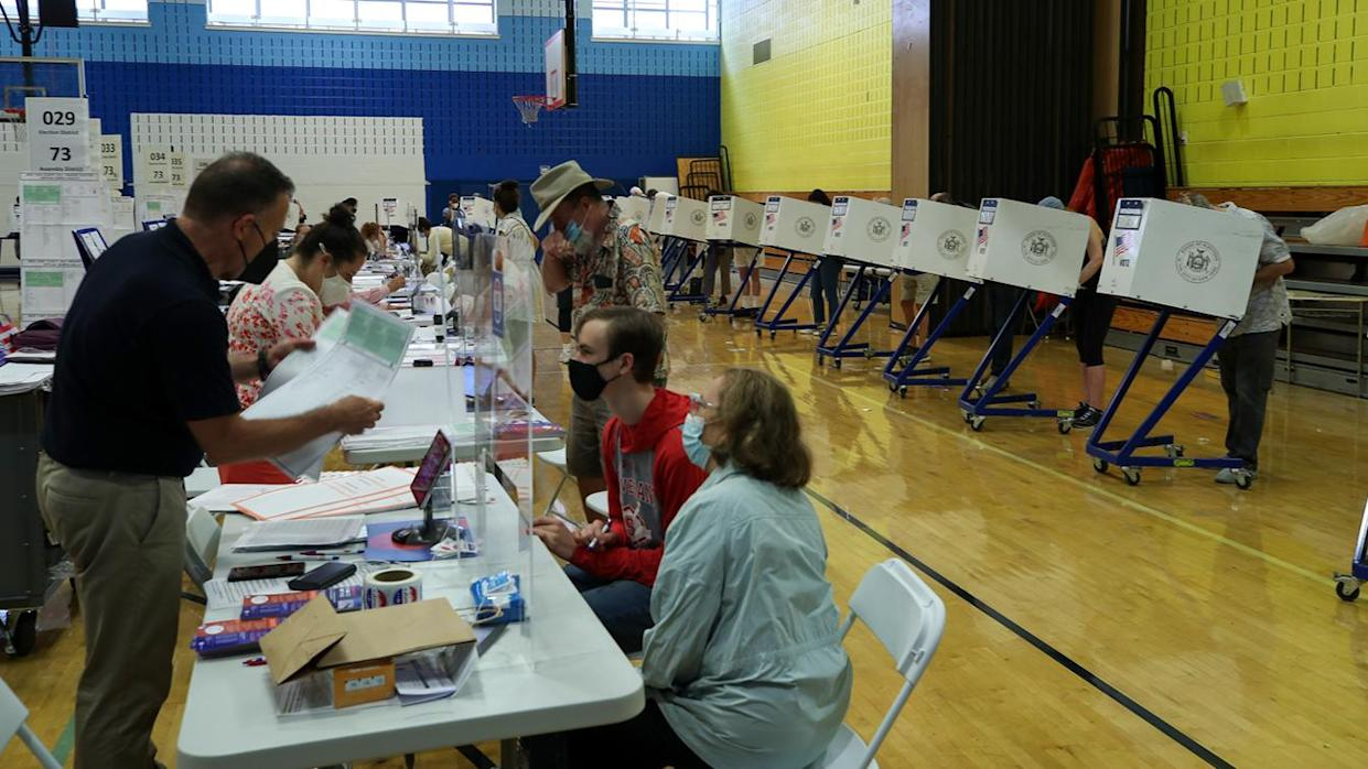 New Yorkers cast their votes in the mayoral primary election in New York on June 22, 2021.