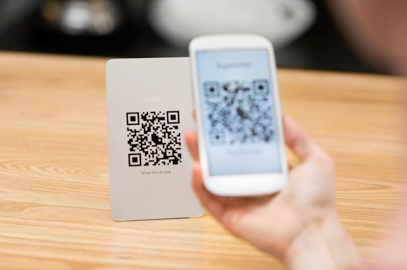 Shopper uses QR code on a smartphone to make a purchase.