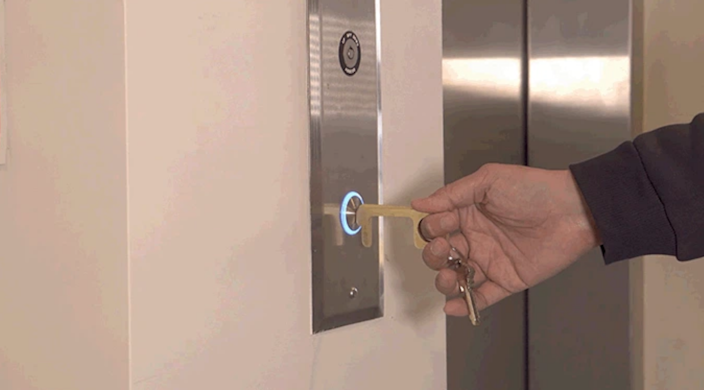 Use the antimicrobial Hygiene Hand tool to push elevator buttons and open doors.