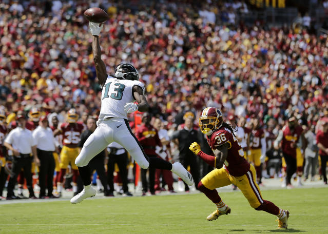 <p>Philadelphia Eagles wide receiver Nelson Agholor, left, makes a catch in front of Washington Redskins free safety D.J. Swearinger in the first half of an NFL football game, Sunday, Sept. 10, 2017, in Landover, Md. (AP Photo/Mark Tenally) </p>