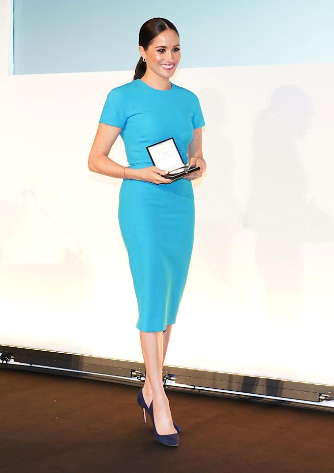 Wearing a Victoria Beckham dress. (Getty Images)