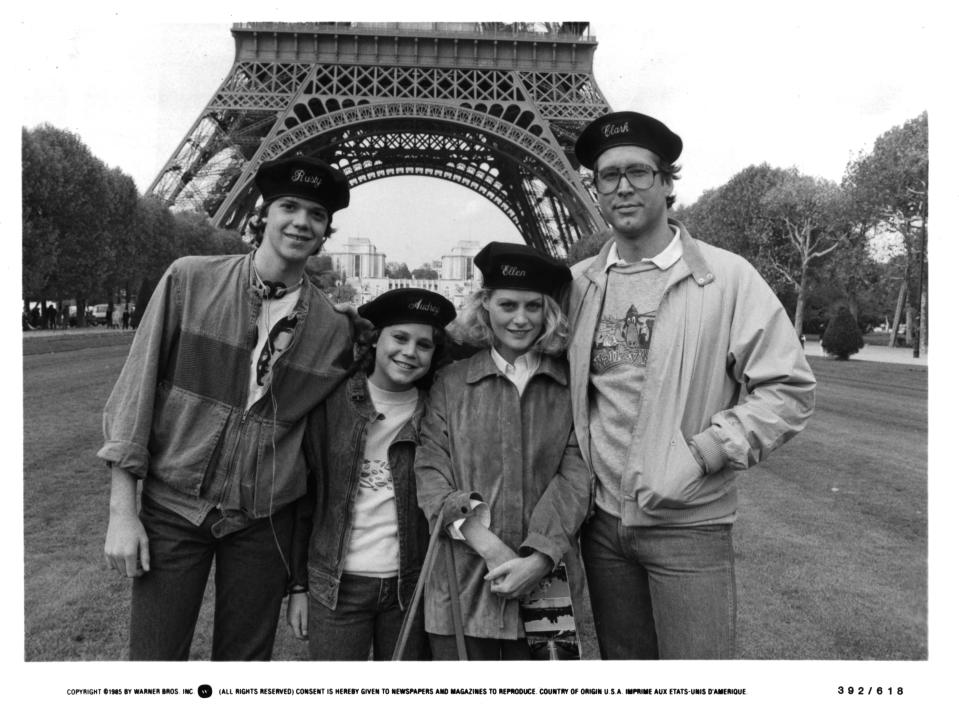 """Actor Jason Lively and actresses Dana Hill and  Beverly D'Angelo and actor Chevy Chase on set of the Warner Bros. movie National Lampoon's  """"European Vacation"""" in 1985. (Photo by Michael Ochs Archives/Getty Images)"""