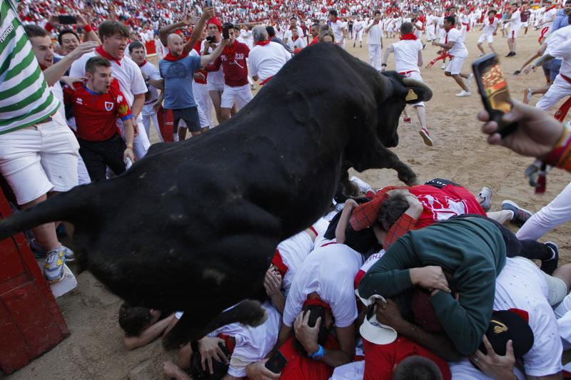 A cow jumps over revellers following the running of the bulls at the San Fermin Festival, in Pamplona, northern Spain, Wednesday, July 10, 2019. (Photo: Alvaro Barrientos/AP)
