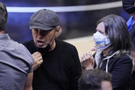 Actor Billy Crystal, left, stands with his wife Janice after the Clippers defeated the Phoenix Suns 106-92 in Game 3 of the NBA basketball Western Conference Finals Thursday, June 24, 2021, in Los Angeles. (AP Photo/Mark J. Terrill)