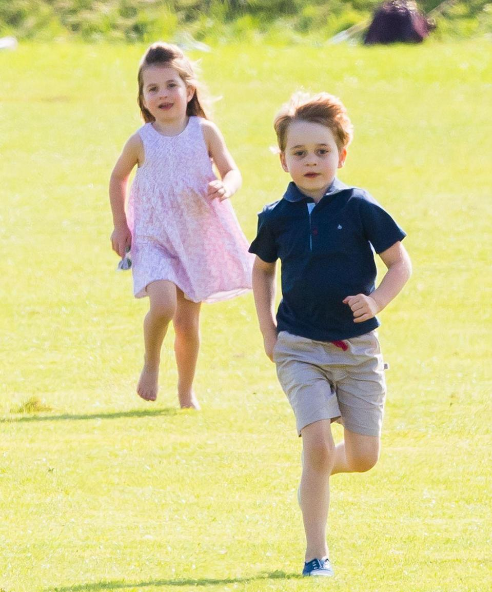 <p>The Cambridge children prove they're just like us by playing in a totally random field at a polo match in 2018. Princess Charlotte even went barefoot!</p>