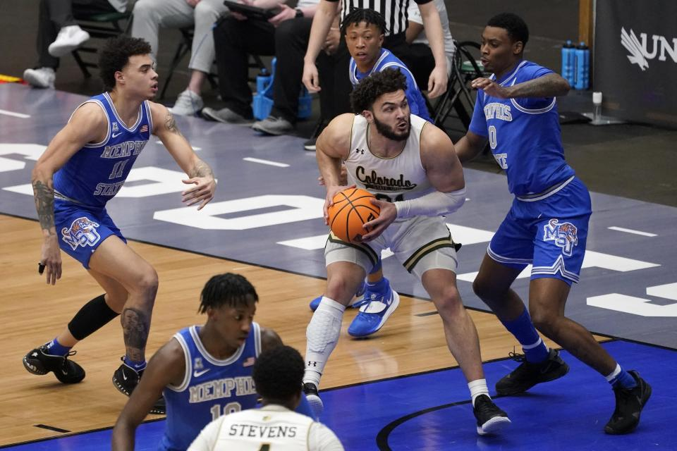 Memphis guard Lester Quinones (11), D.J. Jeffries (0), and Boogie Ellis, rear, defend as Colorado State guard David Roddy (21) works to the basket for a shot in the second half of an NCAA college basketball game in the semifinals of the NIT, Saturday, March 27, 2021, in Frisco, Texas. (AP Photo/Tony Gutierrez)