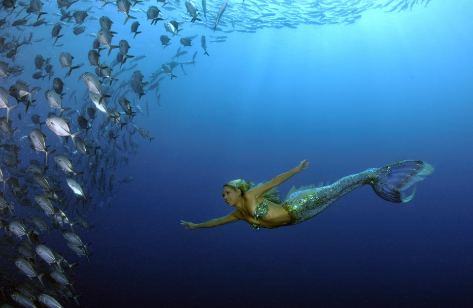 """Hannah Fraser is a professional """"mermaid,"""" ocean environmentalist, performance artist and model. Learn more about her <a href=""""http://hannahmermaid.com/"""" rel=""""nofollow noopener"""" target=""""_blank"""" data-ylk=""""slk:HERE."""" class=""""link rapid-noclick-resp""""> HERE. </a>"""