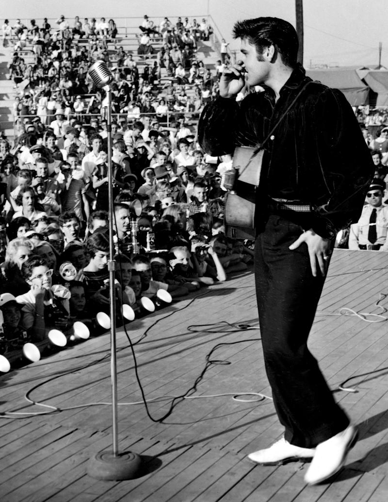 Elvis Presley made his only appearance on the Grand Ole Opry in 1954. Here, he sings in one of two grandstand shows at the Mississippi-Alabama State Fair on Aug. 26, 1956. The young star caused a near riot with his singing in Tupelo, Miss., where he was born.