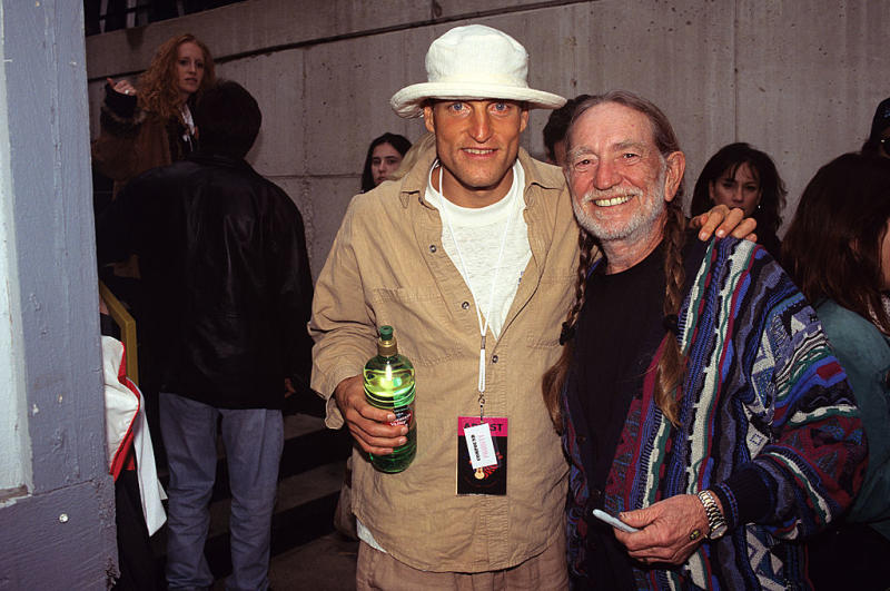 Willie Nelson and Woody Harrelson attend Farm Aid on Oct. 3, 1998, at New World Music Theater in Tinley Park, Ill. (Photo: Ebet Roberts/Redferns)