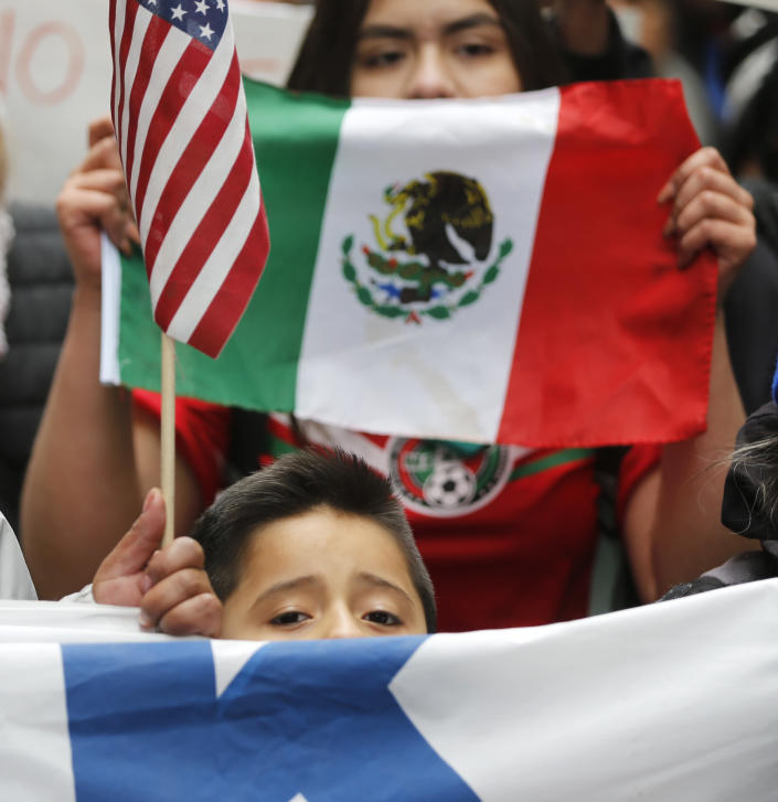 A young boy participates in a protest and march aimed squarely at President Donald Trump's efforts to crack down on immigration Thursday, Feb. 16, 2017, in Chicago. Immigrants around the country have been staying home from work and school today, hoping to demonstrate their importance to America's economy and its way of life. (AP Photo/Charles Rex Arbogast)