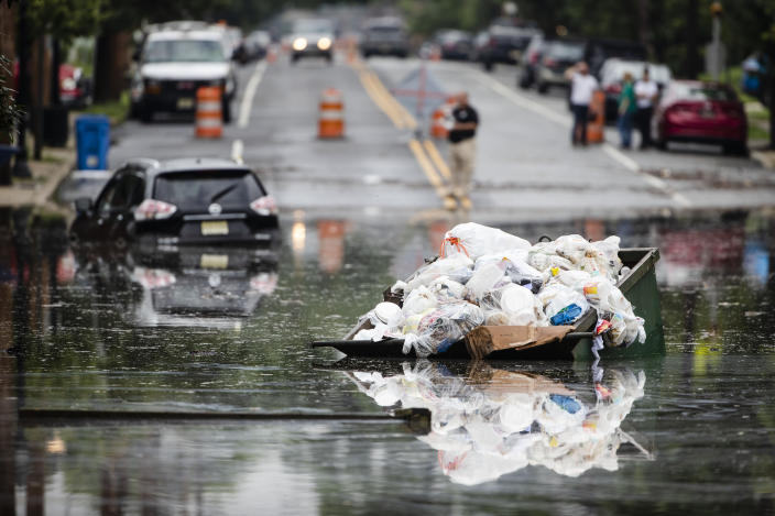 A dumpster floats on floodwater along Broadway in Westville, N.J. Thursday, June 20, 2019. Severe storms containing heavy rains and strong winds spurred flooding across southern New Jersey, disrupting travel and damaging some property. (Photo: Matt Rourke/AP)