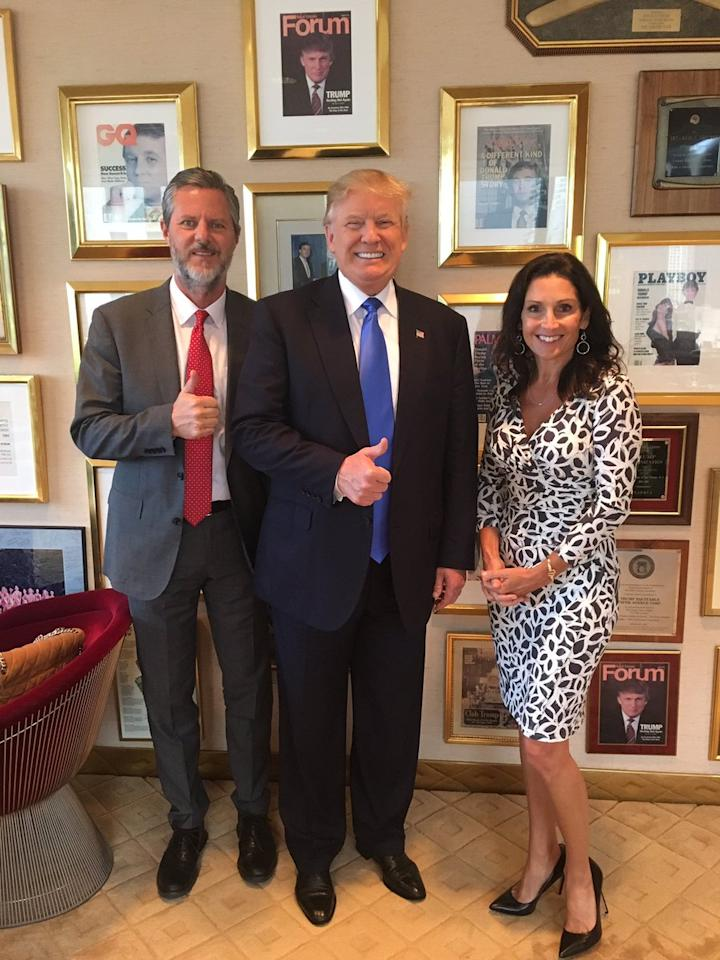 """<p>Jerry Falwell Jr. posted a photo of himself with wife Becki and Donald Trump in Trump's office in Trump Tower on June 21, 2016, in New York City, tweeting, """"Honored to introduce @realDonaldTrump at religious leader summit in NYC today! He did incredible job! @beckifalwell."""" Trump's <em>Playboy</em> cover is visible on the wall behind them. (Photo: Jerry Falwell, Jr. via Twitter) </p>"""