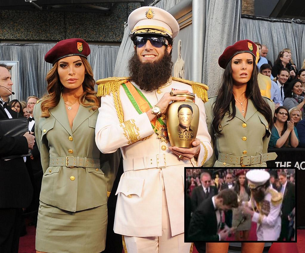 """If there's anyone who takes himself super seriously on the red carpet, it's the beautiful Ryan Seacrest. But the millionaire TV host was thrown for a loop last month while covering the Oscars for E! when Sacha Baron Cohen (wearing a costume from his upcoming film """"The Dictator"""") dumped an urn full of what he pretended were real-life North Korean dictator Kim Jong-il's ashes all over the coiffed correspondent. Ryan wasn't amused and Cohen was abruptly escorted out. (2/26/2012)"""