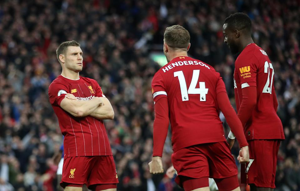 Liverpool's James Milner (left) celebrates after scoring his stoppage time winner against Leicester. (Reuters/Carl Recine)