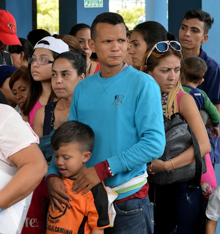 The UN said up to 4,000 people were arriving daily in Ecuador, Peru, Colombia and Brazil (AFP Photo/CRIS BOURONCLE)