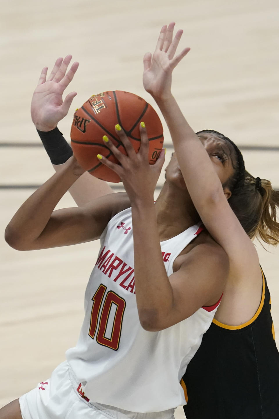 Maryland's Angel Reese (10) shoots against Iowa's Monika Czinano (25) during the first half of an NCAA college basketball game in the championship of the Big Ten Conference tournament, Saturday, March 13, 2021, in Indianapolis. (AP Photo/Darron Cummings)