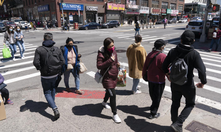 People walk on the street, Monday, April 26, 2021 in New York. The once-a-decade head count of the United States shows where the population grew during the past 10 years and where it shrank. New York will lose one seat in Congress as a result of national population shifts, according to census data released Monday. (AP Photo/Mark Lennihan)