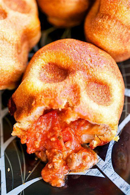 "<p>Get yourself a skull-shaped pan, some pizza dough, sauce, and fillings, and you've got yourself a great night of food. </p><p><strong>Get the recipe at </strong><strong><a href=""https://www.amazon.com/gp/product/B00Y6PRETK/"" rel=""nofollow noopener"" target=""_blank"" data-ylk=""slk:Plain Chicken."" class=""link rapid-noclick-resp"">Plain Chicken.</a></strong></p><p><strong>Tools you'll need: </strong>haunted skull cakelet pan ($39, <a href=""https://www.amazon.com/gp/product/B00Y6PRETK/"" rel=""nofollow noopener"" target=""_blank"" data-ylk=""slk:amazon.com"" class=""link rapid-noclick-resp"">amazon.com</a>)</p>"