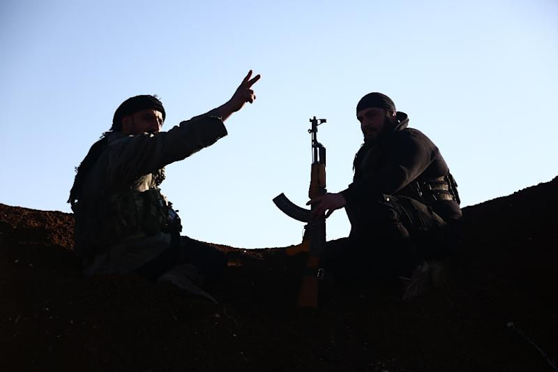 Turkey-backed fighters of the Free Syrian Army hold a position in the Tal Malid area north of Aleppo as they prepare to target Kurdish YPG positions in the Afrin area on January 20, 2018 (AFP Photo/Nazeer al-Khatib)